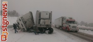 Semitrailer jack knifed on I-15 at mile post 37 during a snow storm. Black ridge area of I-15 in Washington County, Utah, Dec. 7, 2013 | Photo courtesy of Utah Highway Patrol, St. George News