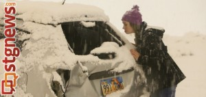 Kember Childers inspects the damage to her Pontiac Vibe after a slide-out on Red Hills Parkway, St. George, Utah, Dec. 7, 2013 | Photo by John Teas, St. George News