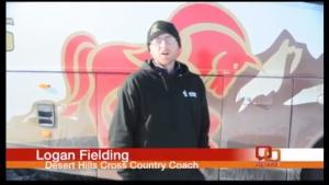 Desert Hills High School Coach Logan Fielding gives interview after night with track team stuck on I-15 in the Virgin River Gorge. Desert Hills High School, St. George, Utah, Dec. 8, 2013 |  Photo by Shane Brinkerhoff, St. George News
