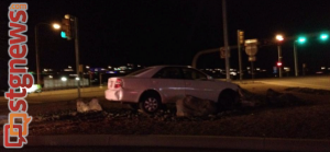 Car comes to rest on traffic island near Dixie Drive interchange with I-15, St. George, Utah, Dec. 226, 2013 | Photo by Michael Flynn, St. George News