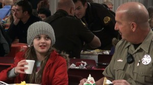 Breakfast was used as a time for the kids and cops to get to know one another. Pancakes, eggs, yogurt, and milk were served for breakfast. KONY Coins for Kids Shop with a Cop, Hurricane, Utah, Dec.14, 2013| Photo by Samantha Tommer, St. George News