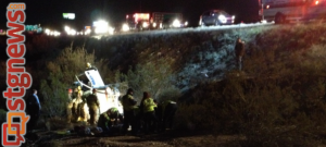 St. George Fire Department works with police and highway patrol to extract one of three injured occupants of a pickup truck that lost control on I-15 and rolled down a steep embankment, Dec. 5, 2013 | Photo by Michael Flynn, St. George News