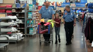 Kids were given $100 dollars to get whatever they want. Many kids decided to get gifts for their family members instead of themselves. KONY Coins for Kids Shop with a Cop, Hurricane, Utah, Dec.14, 2013| Photo by Samantha Tommer, St. George News