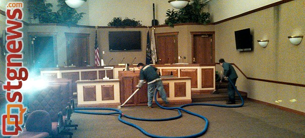 A restoration crew works to remove the water from the council chamber's carpet, Washington City, Utah, Dec. 11, 2013 | Photo by Mori Kessler, St. George News