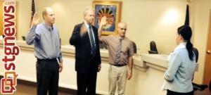 (L-R) Ivins Councilman Cheyne McDonald, Mayor Chris Hart and Councilman Steven Roberts are sworn in by Ivins City Clerk/Recorder Kari Jimenez, Ivins, Utah, Jan. 2, 2014 | Photo courtesy of Dale Coulam