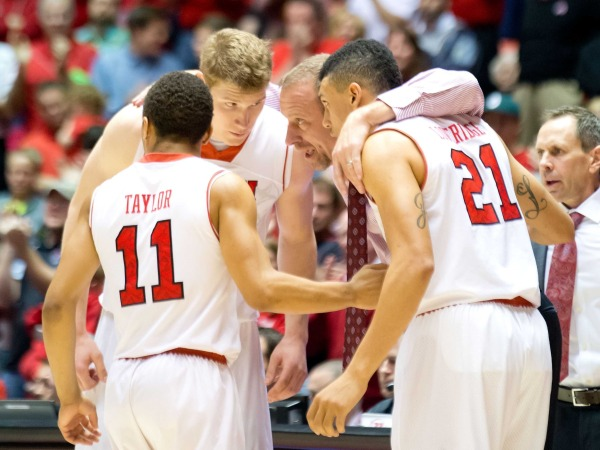 Utah Utes head coach Larry Krystkowiak huddles with guard Brandon Taylor (11) and forward Jordan Loveridge (21) and center Dallin Bachynski (31) during the second half against the UCLA Bruins at Jon M. Huntsman Center. Utah won 74-69, Salt Lake City, Jan. 18, 2014 | Photo by Russ Isabella, USA TODAY Sports via Utah Athletics