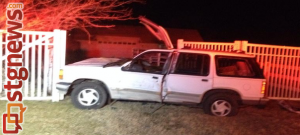 A vehicle crashed into a fence near Brigham Road, St. George, Utah, Jan. 29, 2014 |Photo by Scott Heinecke, St. George News