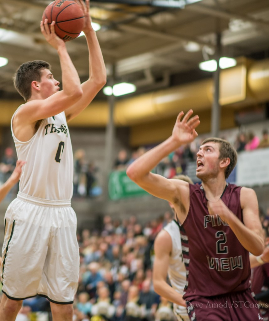 Trey Tanner attempts a shot over Kody Wilstead, Pine View at Desert Hills, St. George, Utah, Jan. 17, 2014 | Photo by Dave Amodt, St. George News