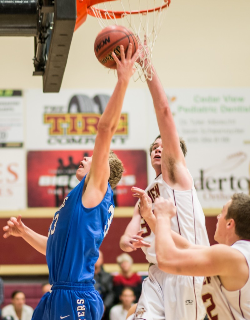 Harrison Labrum (in blue) tries to get a shot past Dustin Staggs, Dixie at Cedar, Cedar City, Utah, jan. 22, 2014 | Photo by Dave Amodt, St. George News