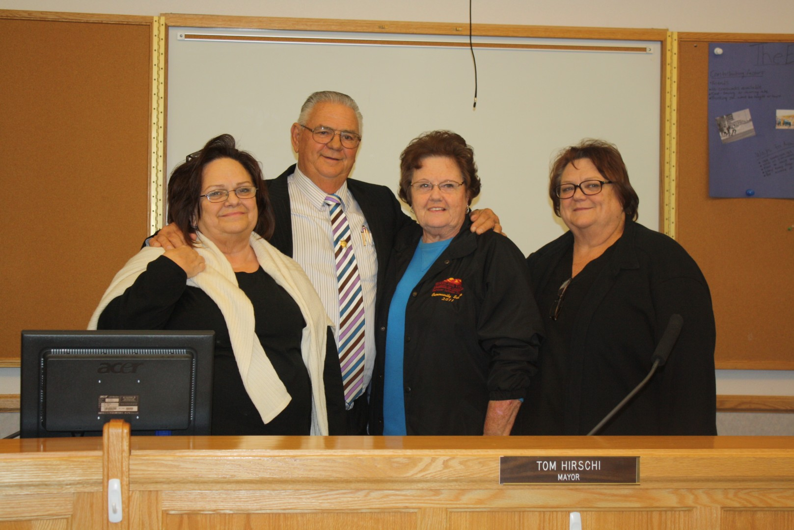 Former Mayor Tom Hirschi poses with his three sisters after his final City Council Meeting as mayor. Hurricane City Council Chambers, Hurricane, Utah, Jan. 3, 2014 | Photo by Reuben Wadsworth, St. George News