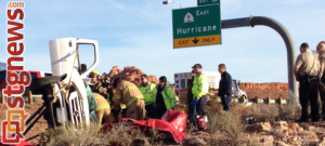 Rescue workers struggle to extricate a man from a vehicle that rolled over on I-15 in Washington. Jan 2, 2014 | Photo by Michael Flynn, St. George News