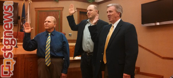(Left-right) Washington City Councilmen Garth Nisson and Thad Seegmiller and Mayor Ken Neilson being sworn in as they each begin a new term as members of the Washington City Council, Washington City, Utah, Jan. 6, 2014 | Photo by Mori Kessler, St. George News