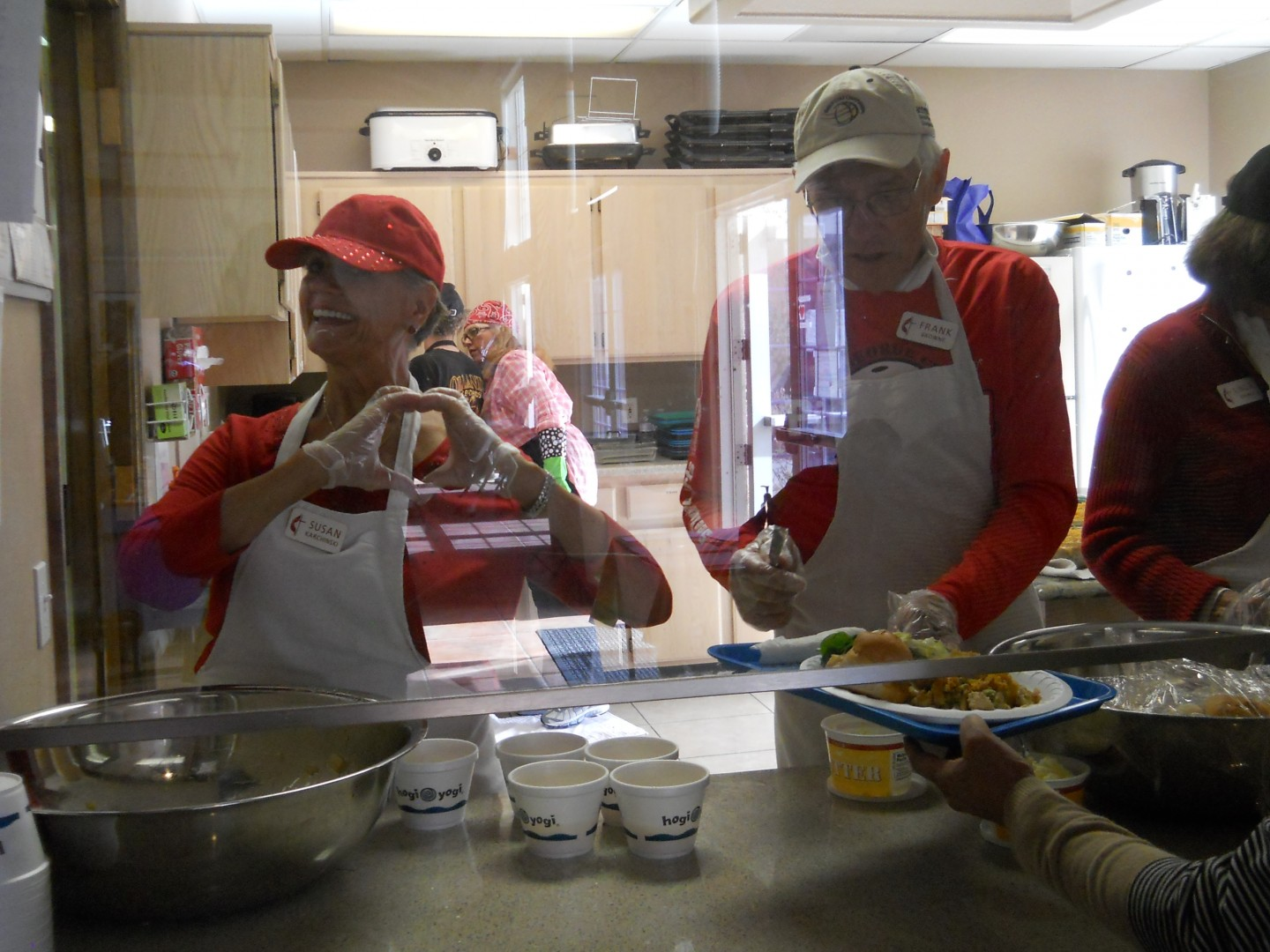 Volunteers serve casserole and show Valentine spirit at the community soup kitchen at Grace Episcopal Church, St. George, Utah, Feb. 14, 2014 | Photo by Aspen Stoddard, St. George News