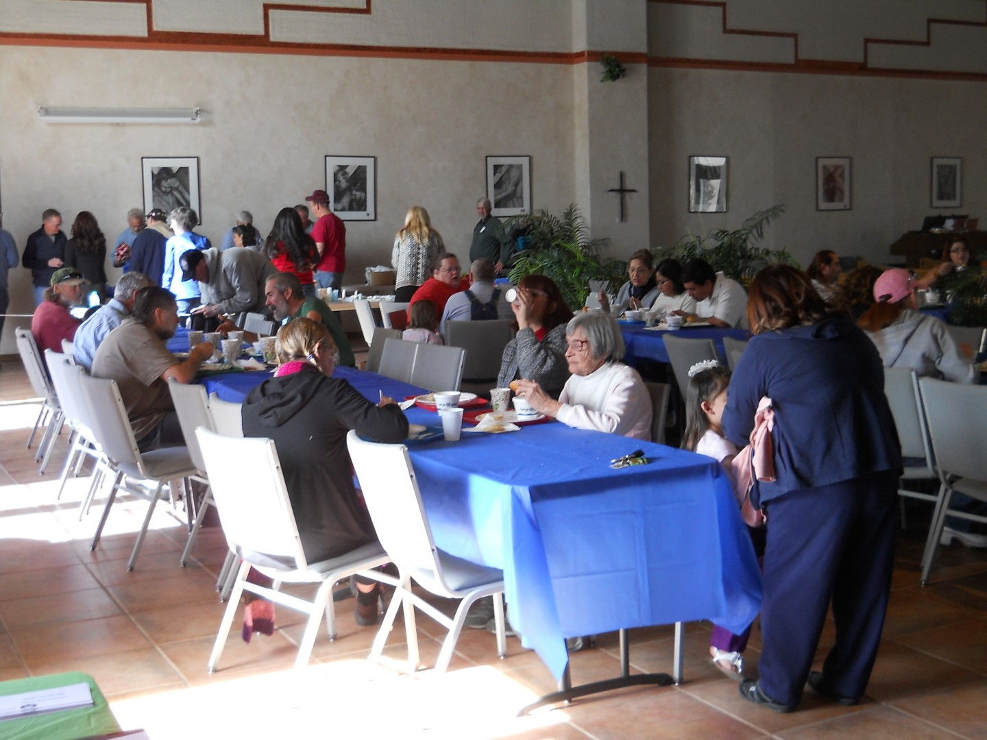 Guests sit at the tables at the community soup kitchen at Grace Episcopal Church, St. George, Utah, Feb. 14, 2014 | Photo by Aspen Stoddard, St. George News