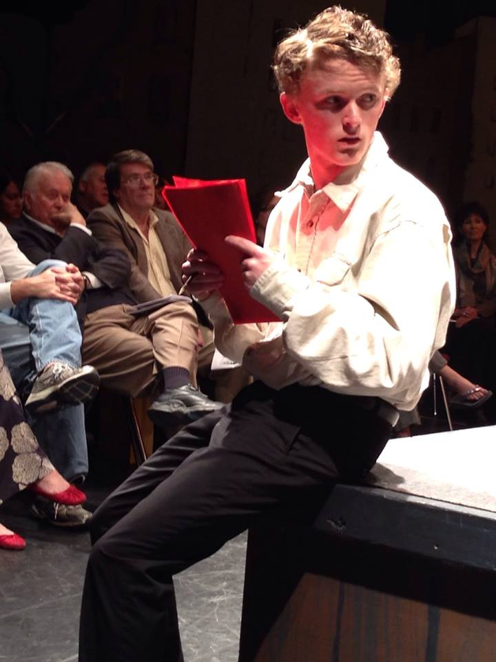 Thomas Rogers watches from a front row seat as Pine View High School cast memeber perfroms his play, St. George, Utah, Feb. 19, 2014 | Photo by Kimberly Scott, St. George News