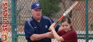 Coach Gordon Eakin teaching a young girl batting at the BYU Softball clinic, St. George, Utah, Feb. 8, 2014   Photo by John Teas, St. George News
