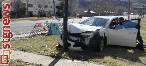 A woman driving northbound on State Street through LaVerkin passed out and crashed into a sign post, LaVerkin, Utah, Feb. 10   Photo courtesy of the LaVerkin Police Department, St. George News