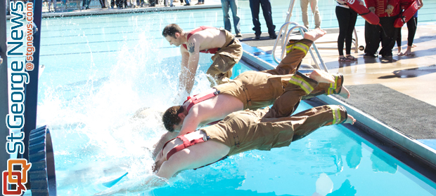 Members from the St. George City Fire Department plunge into the icy water at St. George City Pool, St. George, Utah, Feb. 22, 2014 | Photo by Amber Green, St. George News