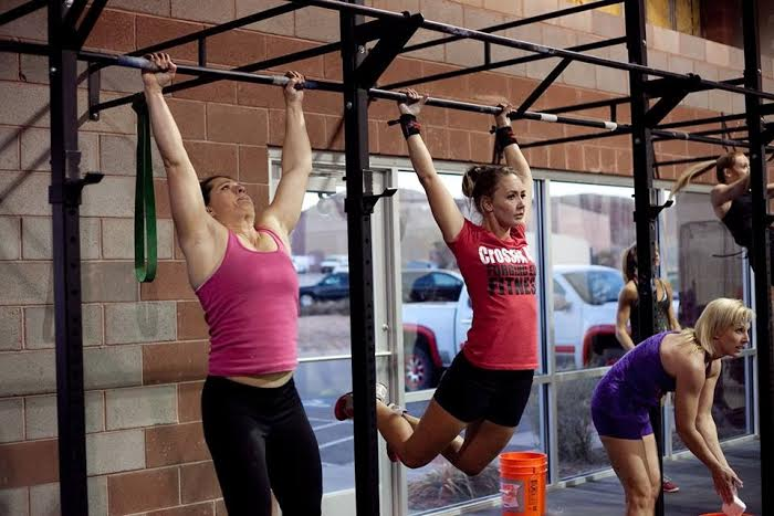 Heather Huntsman wearing a red CrossFit shirt performs a WOD, workout of the day, Hurricane, Utah, Nov. 23, 2013 | Photo by and courtesy of Susannah Stout, St. George News