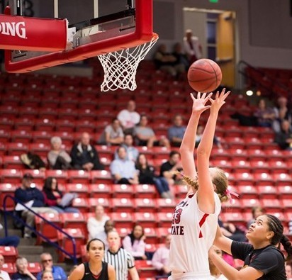 Taylor Mann grabs one of her school-record 26 rebounds Thursday night, Hawaii-Hilo at Dixie State, Feb. 13, 2014 | Photo courtesy DSU Athletics