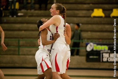 Taylor Mann gets a hug from teammates after hitting the game-tying 3-pointer Thursday night, Dixie State vs. Dominican, San Diego, Calif., March 6, 2014 | Photo courtesy DSU Athletics