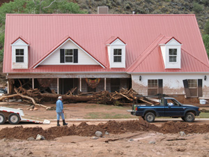 House near the town of Virgin damaged by flash flood along North Creek, Virgin, Utah, Aug, 2007 | Image courtesy of Utah Geological Survey