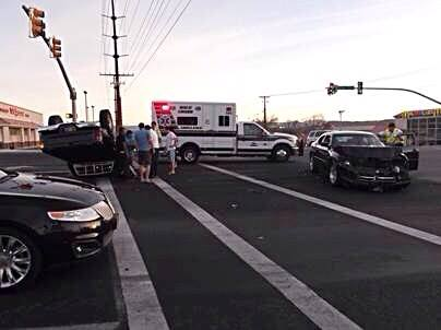 Car accident results in rollover at Sunset Boulevard and Dixie Drive, St. George, Utah, March 16, 2014 | Photo courtesy of the St. George Police Department, St. George News