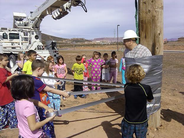 Hurricane Elementary students wind duct tape across Principal Wilstead, Hurricane, Utah | photo by Aspen Stoddard, St. George News