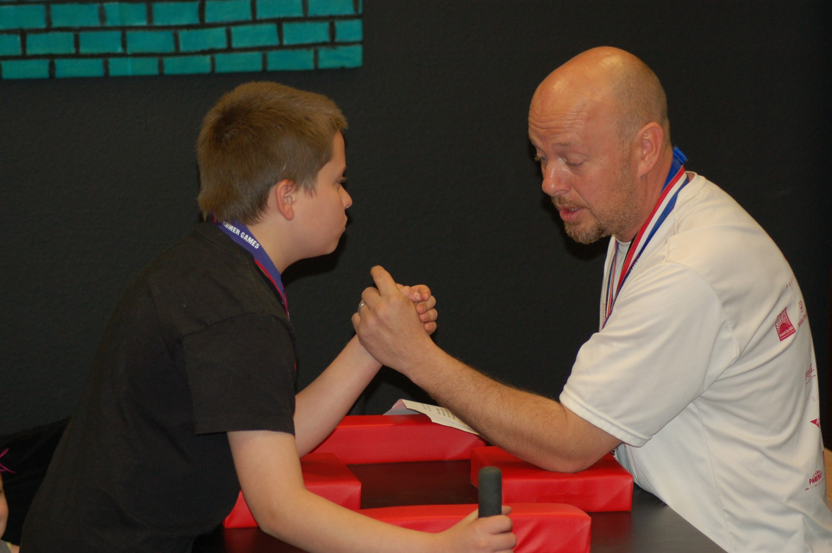 Jarett Kirby and Jeff Kirby demonstrate to the students the proper form for arm wrestling at an assembly held at Bloomington Elementary, St. George, Utah, April 4, 2014 | Photo by Hollie Reina, St. George News