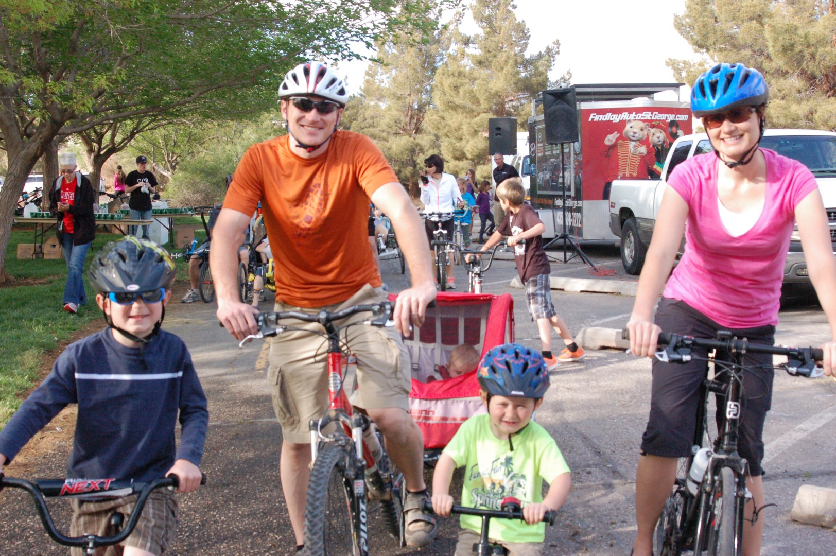 The McCausland family, L-R Rockwell, 6, Luke, Grant, 3, and Tara (10 month old Logan in back), waits for their turn to start riding at the Family Fun Bike Ride, held at Tonaquint Nature Center, St. George, Utah, April 12, 2014 | Photo by Hollie Reina, St. George News