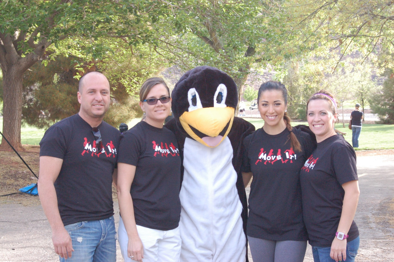 L-R Tracy Stevens, Rebecca Stevens, unnamed penguin, Josie Martinez, Sarah Reber, mentors in the Move It program pose for a photo at the Family Fun Bike Ride held at Tonaquint Nature Center, St. George, Utah, April 12, 2014   Photo by Hollie Reina