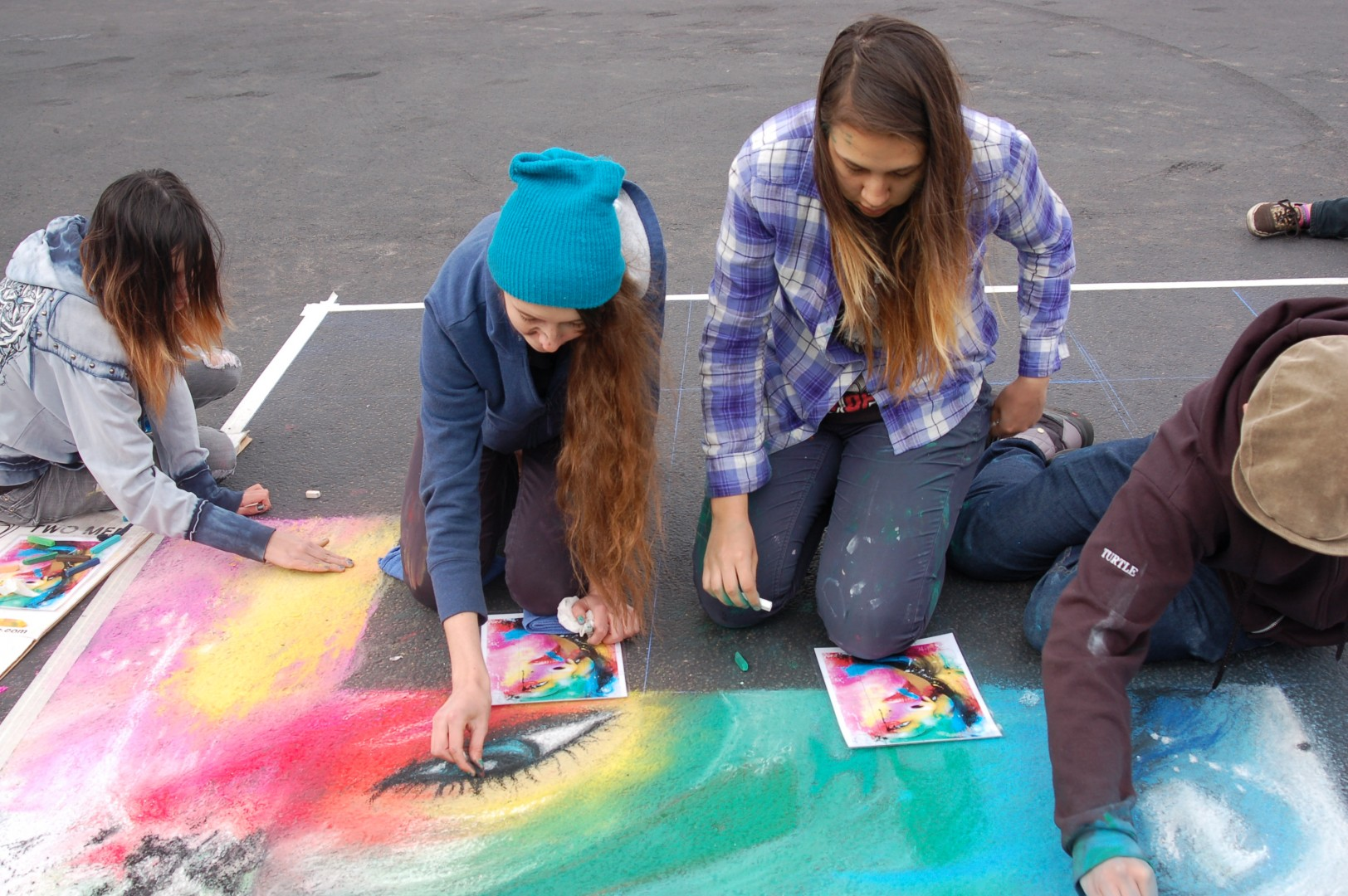 Students from Tuachan High School for the Arts create their entry for the student competition at the Kayenta Street Painting Festival, Ivins, Utah, April 26, 2014 | St. George News