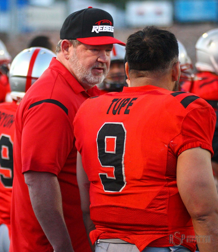 Coach Dale Stott and quarterback Misi Tupe discuss game strategy, Wasatch Revolution at Dixie Rebels, St. George, Utah, Apr. 5, 2014 | Photo by Robert Hoppie, St. George News