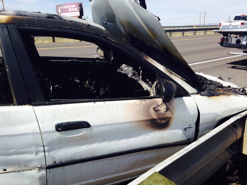 Fire damage to a 2002, white Honda Civic caused after the vehicle crashed into a guard rail on  northbound I-15 near mile marker 61, Cedar City, Utah , April 8, 2014 | Photos courtesy of Bryan Hyde
