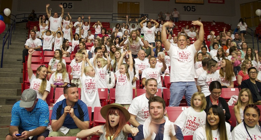 The crowd gets excited waiting for the countdown. World record-breaking party poppers event, Burns Arena, Dixie State University, St. George, Utah, April 10, 2014   Photo by Samantha Tommer, St. George News
