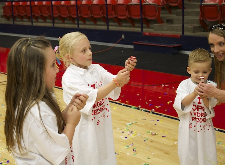 Children receive instruction on how to pop their party poppers. World record-breaking party poppers event, Burns Arena, Dixie State University, St. George, Utah, April 10, 2014 | Photo by Samantha Tommer, St. George News