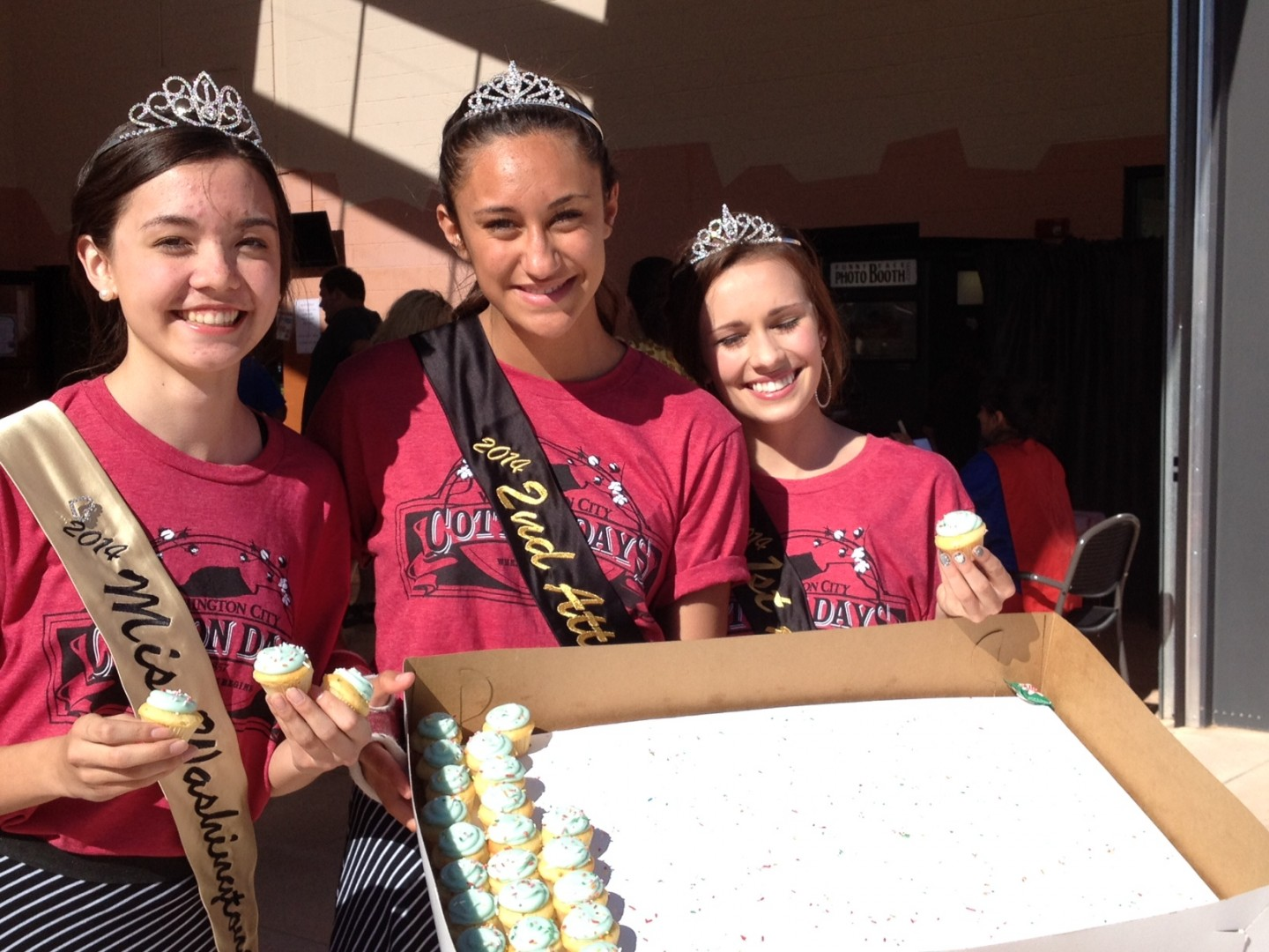 L-R, Naomi Lin, Tayvia Ahquin, Emilee Taylor, members of the Washington City Royalty hand out free cupcakes at the sixth anniversary of the Washington City Community Center, Washington City, Utah April 28, 2014 | Photo by Hollie Reina, St. George News