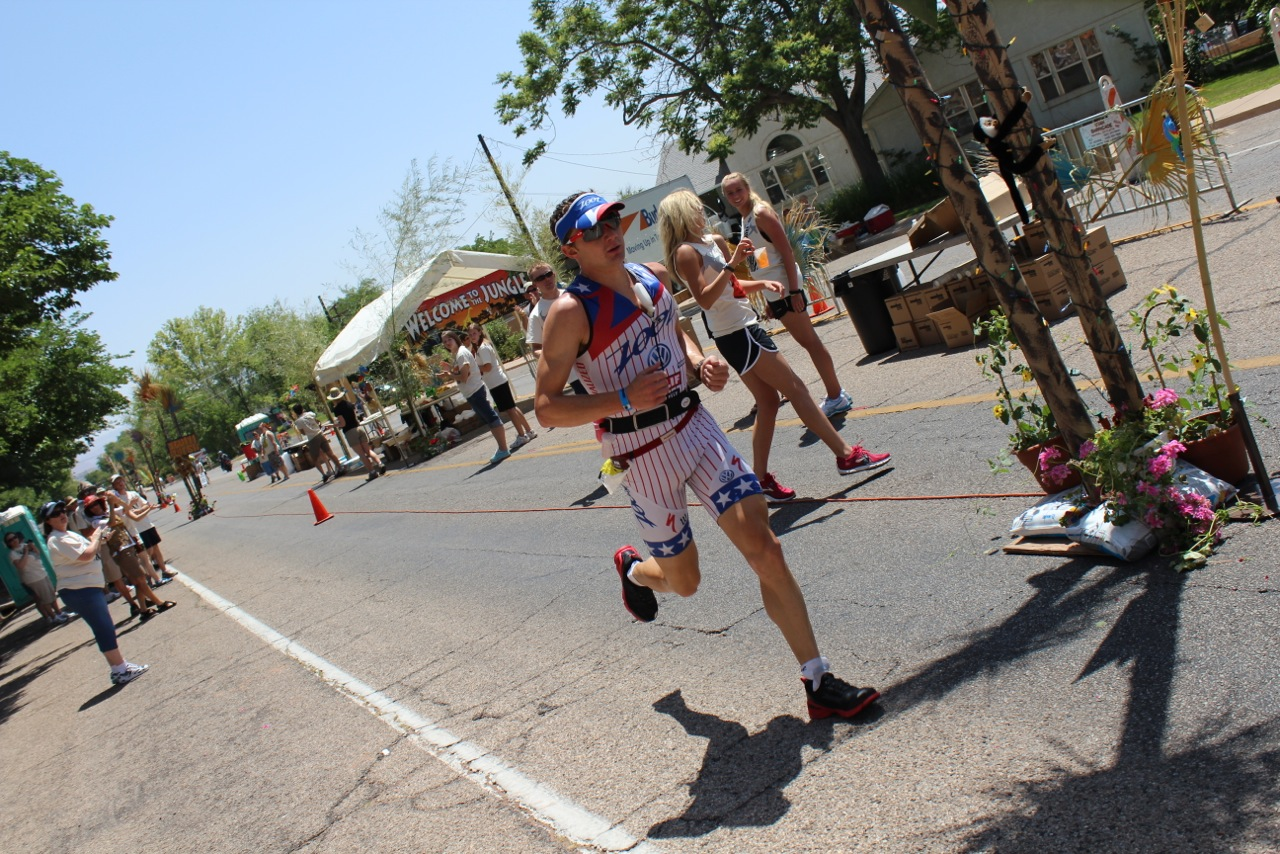 A runner comes through an aid station set up at Ironman St. George, St. George, Utah, Date not specified   Photo courtesy of Niki Warner