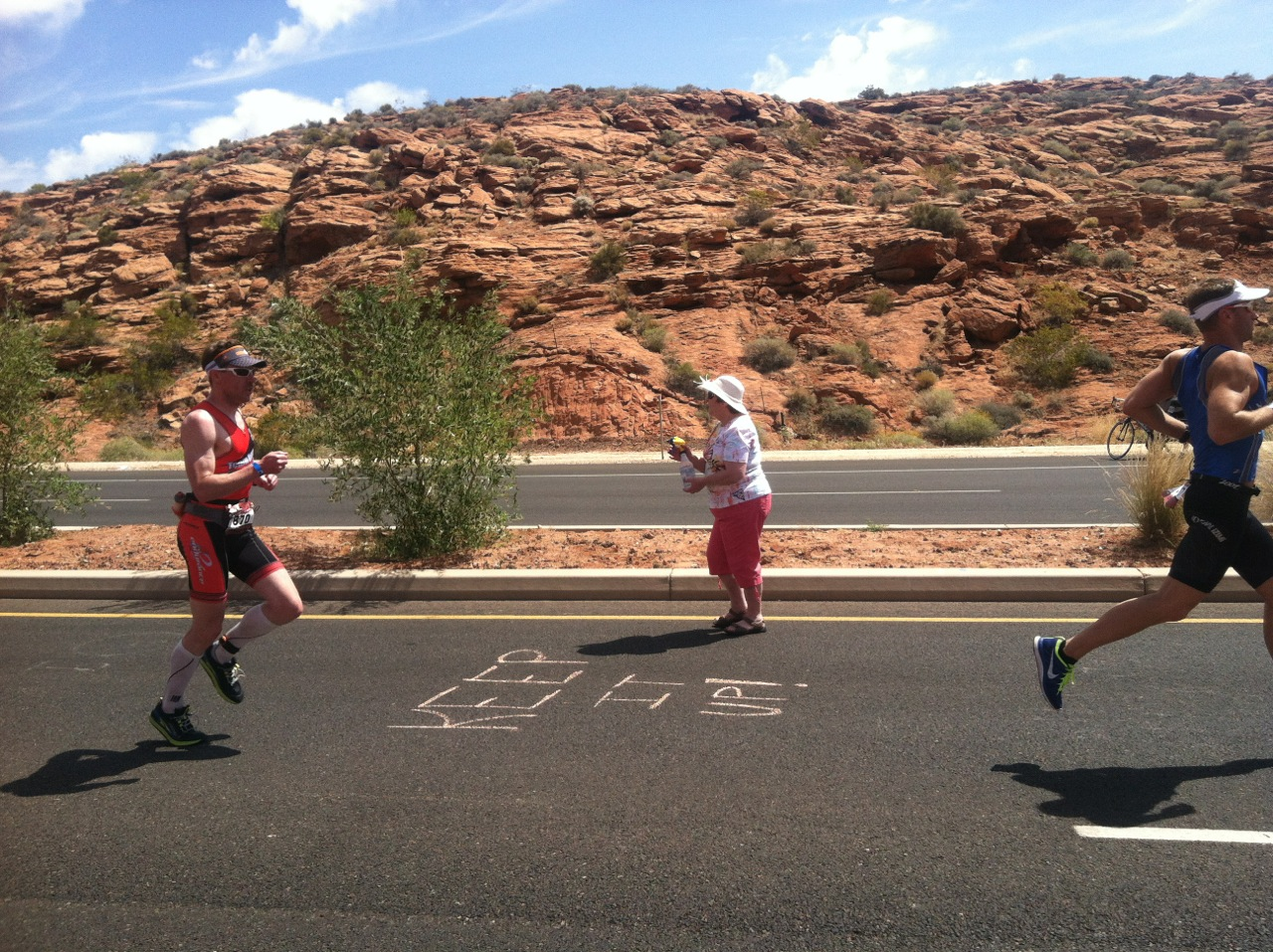 Athletes run past encouraging signs left by volunteers at Ironman St. George, St. George Utah, Date not specified | Photo courtesy of Niki Warner