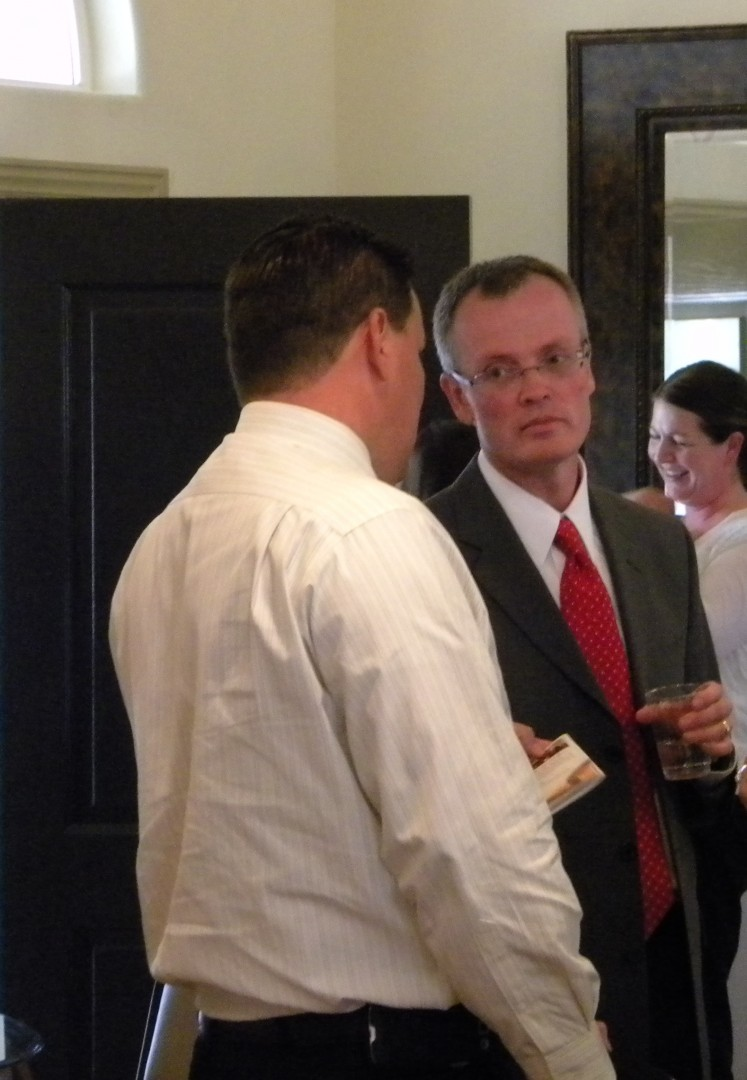 Brock Belnap greets people at debate. St Geroge, Utah | Photo by T.S Romney St George News