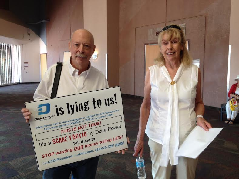 Gary Engelman and Shirley Nelson hold protest signs and information at the Dixie Power annual dinner and meeting held at the Dixie Center, St. George, Utah, May 28, 2014 | Photo by Hollie Reina, St. George News