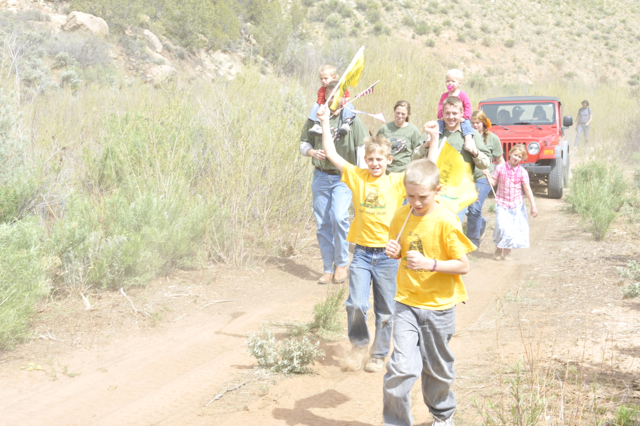 Children running alonside protest ride through Recapture Canyon. near Blanding, Utah, May 10, 2014 | Photo by Dallas Hyland, St. George News