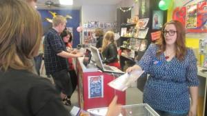 Getting a free comic book, St. George, Utah, May 3, 2014 | Photo by Mori Kessler, St. George News