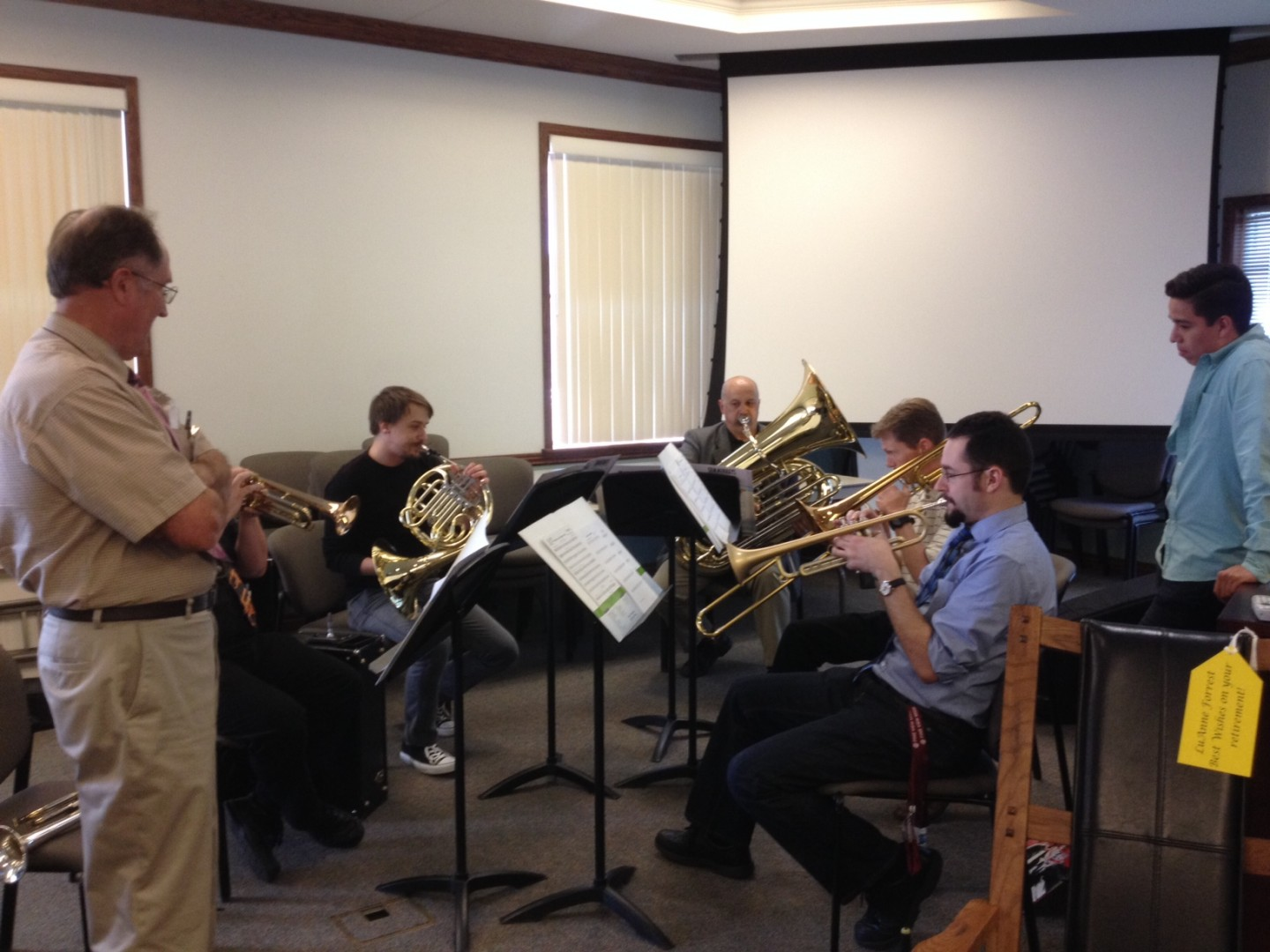 Ferron Holt watches a jazz band made up of former students and colleagues at a reception honoring retiring Washington County School District employees at the District Office. St. George, Utah, May 7, 2014 | Photo by Hollie Reina, St. George News