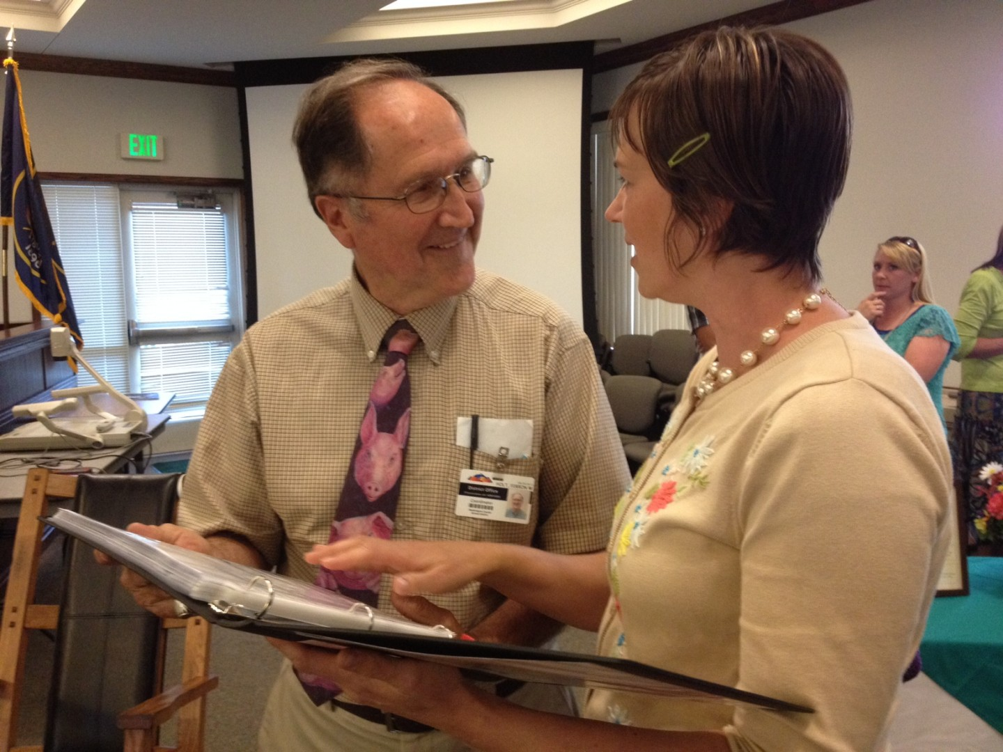 Ferron Holt is presented a book of thank you notes and memories compiled by his daughter Kirsten Holt Beitler at the Washington County School District reception for retiring employees. St. George, Utah, May 7, 2014 | Photo by Hollie Reina, St. George News