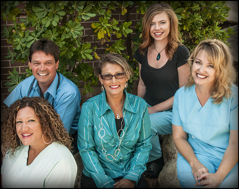 L-R Front row: Sueann Roberts, medical assistant-shot nurse, Lisa Stearns, office manager, Kris Moffitt, medical assistant; L-R Back row: Dr. Kenneth R. Pinna, Melissa Jetmore, receptionist.  Southwest Allergy and Asthma Clinic, St. George, Utah, undated   Photo courtesy of Southwest Allergy and Asthma Clinic, St. George News
