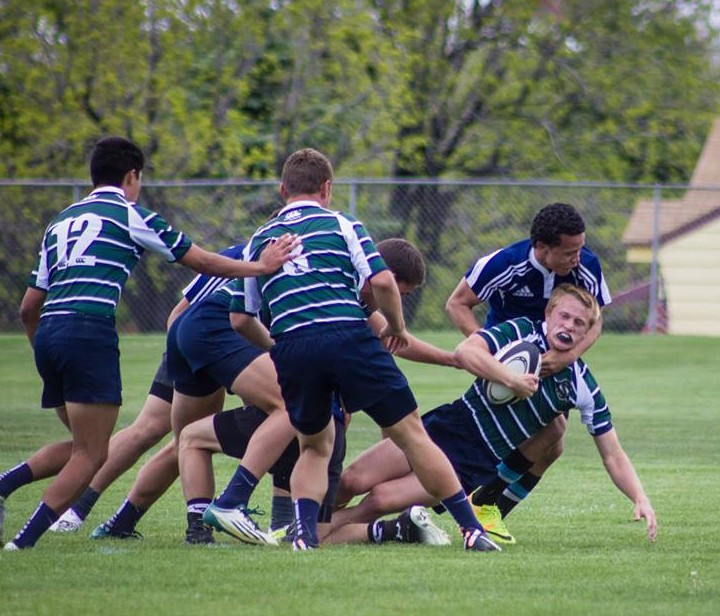 SC's Connor Parry is tackled hard, state rugby semifinal game, Salt Lake City, Utah, May 16, 2014 | Photo courtesy Cambria Horlacher Hauck