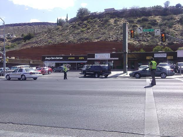 St. George police officers redirect southbound traffic through the parking lot at the intersection of 300 North and Bluff Street, St. George, Utah, May 29, 2014 | Photo by Aspen Stoddard, St. George News