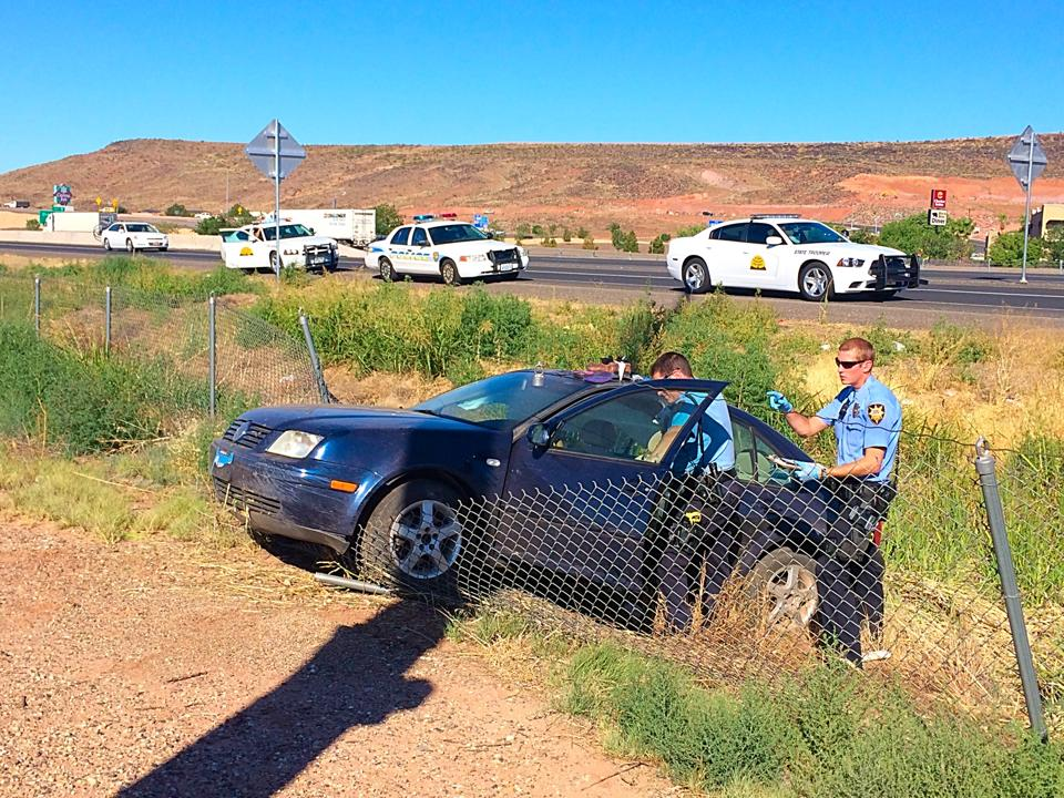 Suspect crashes car near Exit 6 on I-15 before fleeing on foot, St. George, Utah, June 19, 2014 | Photo by Kimberly Scott, St. George News