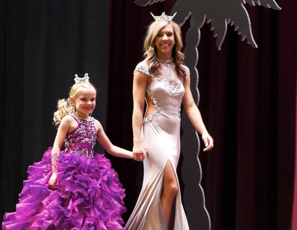McCall Spears, Miss Washington County 2013 takes her final walk with Brinlee Hurdsman, Little Miss Washington County 2013 at Desert Hills High School, St. George, Utah, June 28, 2014 | Photo by Samantha Tommer, St. George News